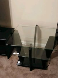 rectangular glass-top table with black steel base 44 km