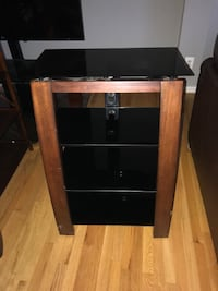 brown wooden framed glass TV stand 18 mi