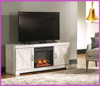 black flat screen TV; white wooden TV stand Katy