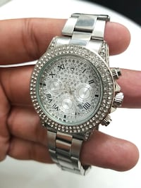 round silver-colored chronograph watch with link bracelet Brampton, L6R 1K5
