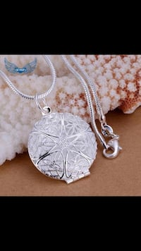 Brand new 925 Sterling Silver Necklace you can put mini photo  Calgary, T3P 0K3