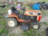 I nice old rideing mower 16hp motor.  Need a  fuel Royse City, 75189