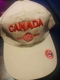 Band New - ZORAN  CANADA CAP  Tan with Red Writing.