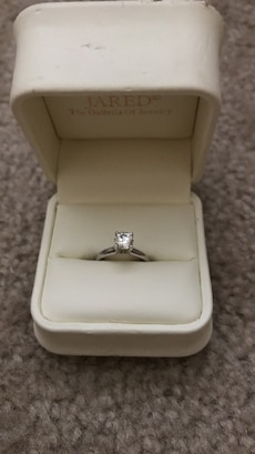 diamond and silver solitaire ring in box