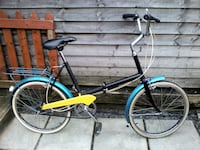 black and blue city bike Surrey