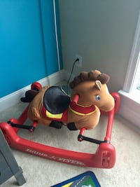red, brown, and black Radio Flyer ride on horse plush toy Ashburn