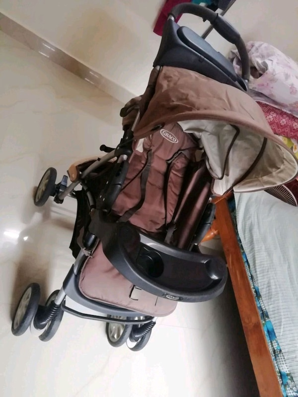 baby's black and brown stroller