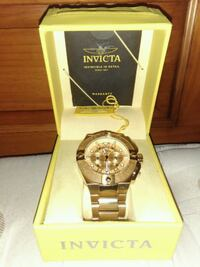 round gold-colored Rolex analog watch with link  Miramar, 33027