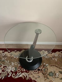 Single glass side table