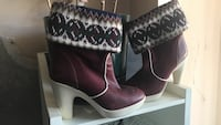 pair of women's brown leather chunky heel boots Toronto, M6K 1G6