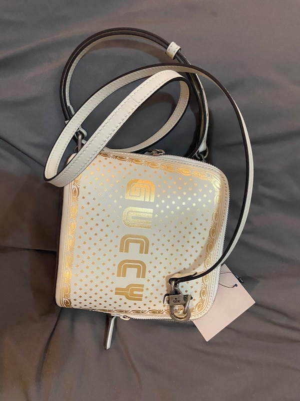 Authentic new Gucci moon and star crossbody bag 0
