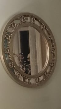 round silver-colored framed mirror Stoney Beach, 21226