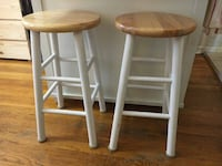 two white-and-brown wooden stools New York, 10028