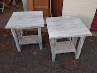 two square white wooden 2-tiered side tables
