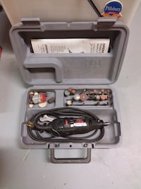 Dremel tool with case and bits
