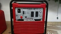 red and gray Hona industrial portable generator