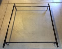 Metal bed frame with wheels