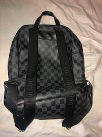 black and brown checkered backpack 1304 km