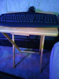 black corded computer keyboard; brown wooden folding table Santee, 92071