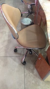brown wooden base with brown leather padded rolling chair Las Vegas, 89139