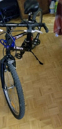 black and blue full suspension mountain bike