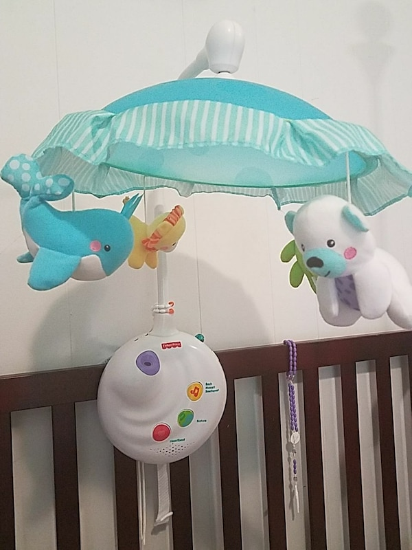 white and blue Fisher-Price crib mobile