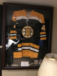 Sports jersey display case
