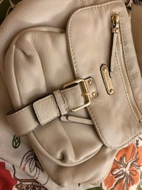 MK Women's cream leather sling bag Toronto, M2R 3P4