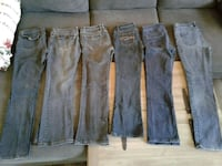 6 pair of blue jeans for $12 (Black jeans are in s