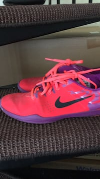 pair of pink Nike running shoes null