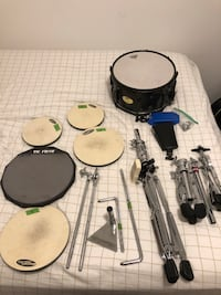 "5 pad drum kit with kick pad. Pork pie snare with ""like new"" head. Cow bell and wooden block. Includes snare stand   Lake Como, 07719"