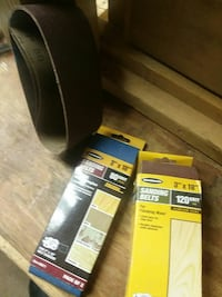 Two full boxes sanding belts one partial
