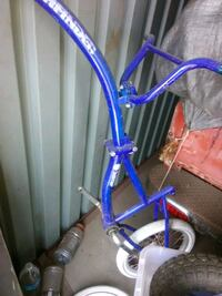 blue and white bicycle frame Mesa, 85203