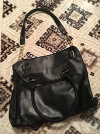 Black, faux leather purse, with gold embellishments. Kenner, 70065