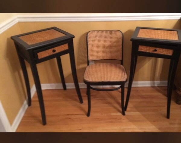 Two brown wooden framed padded chairs