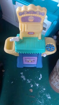 toddler's blue and yellow Little Tikes kitchen pla Chatham-Kent
