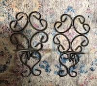 Black wrought iron wall decor, candle holder
