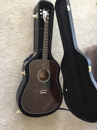 brown dreadnought acoustic guitar in guitar case Montgomery, 77356