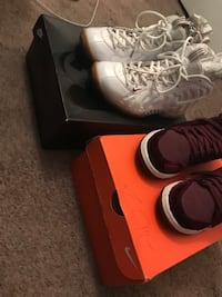 two pairs of white and maroon basketball shoes