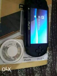 black Sony PSP with 5 games Chandigarh, 160055