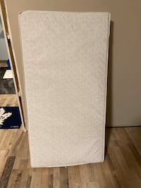 Waterproof crib mattress and support frame