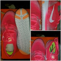 pair of red Nike running shoes Little Rock, 72206