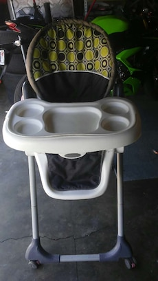 white, black and yellow high chair