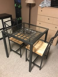 Glass top table and two chairs 50 OBO moving must go  Barrie, L4N