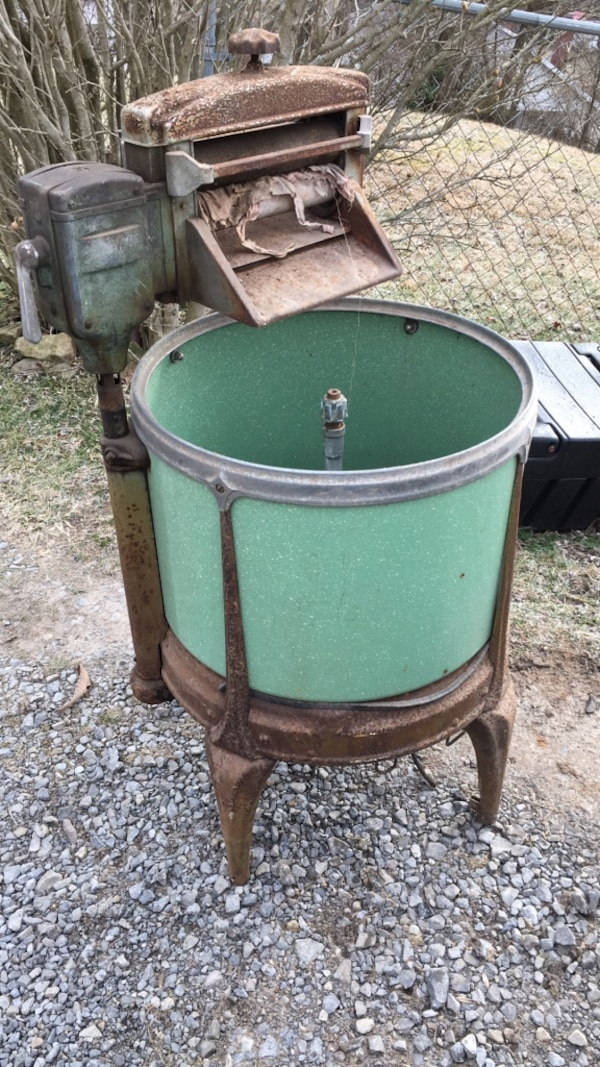 Green and brown metal stand