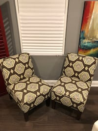 two brown-and-black floral padded chairs 51 km