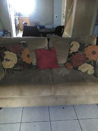 brown micro suede loveseat with throw pillows