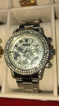 round gold diamond studded chronograph watch with link bracelet Brampton, L6T
