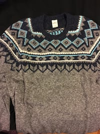 black, teal, and gray tribal print swater