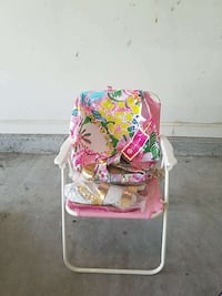 white, pink, green, blue, and yellow floral armchair Summerville, 29483
